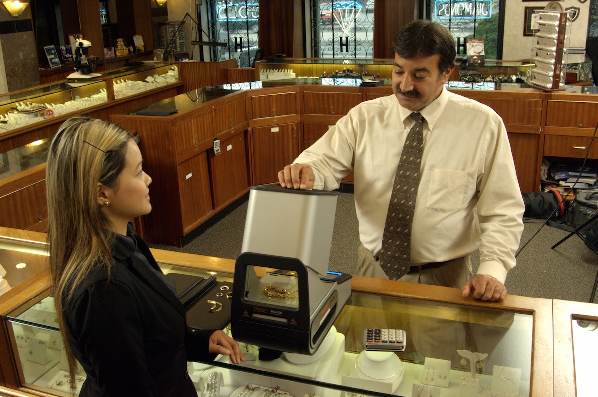 Man measuring the content of gold and precious metals